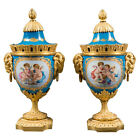A Pair of 19th Century French Gilt Bronze Mounted Sevres Style Painted Vases.
