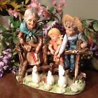 Old Country Woman And Children Feeding the Rabbits Porcelain Figurine Statue