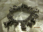 STERLING SILVER VINTAGE CHARM BRACELET LOADED WITH CHARMS
