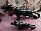 Two Art Deco Black Panther figurine with multi color collars, gold teeth, claws