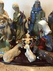 Nativity Set of 11 Pieces Hand Painted Glazed Porcelain Figurines on Wooden Base