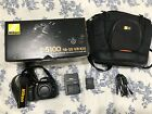 Nikon D5100 162MP DSLR Camera w battery remote bag charger 6093 shutter