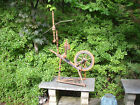 AN EARLY ,PAINT DECORATED FOLK ART ,YOUNG PERSONS SPINNING WHEEL, HEART DECORATI