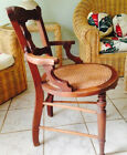 antique chairs over 100yrs. old.Wood Frame with Caned seat