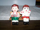 VINTAGE JAPAN BOY WITH INSTRUMENT AND GIRL ON BENCH SALT AND PEPPER SHAKERS