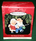 HALLMARK ORNAMENT 1997 FIRST IN THE CLAUSES ON VACATION SERIES