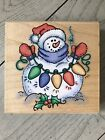 STAMPENDOUS WOOD RUBBER STAMP SNOW LIGHTS SNOWMAN W020