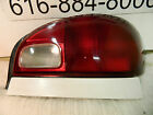 GEO METRO 1995 1997 RIGHT PASSENGER SIDE TAIL LIGHT OEM IN GOOD CONDITION