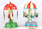 2 TIN TOYS CAROUSEL WITH PEOPLE & PIXIE MUSHROOM ROUNDABOUT GERMAN TIN TOY