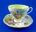 Colorful Floral Bouquet on White Foley with Green Center Tea Cup and Saucer Set