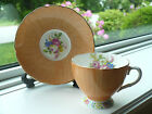 Foley Tea Cup and Saucer Brushed Orange with Flower Bouquet and HP Foot 1930s