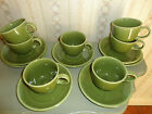HOMER LAUGHLIN RETIRED SHAMROCK GREEN 7 SAUCERS AND 9 CUPS