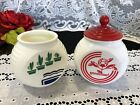Set of 2 Vintage Anchor Hocking Vitrock Grease Jars - Flower Pot and Red Feather