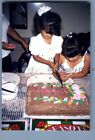 FOUND COLOR PHOTO B_6898 GIRLS POSED CUTTING CAKE WITH KNIGE TOGETHER