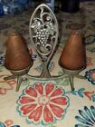 SALT AND PEPPER SHAKERS MADE IN ISREAL METAL HOLDER WOOD SHAKERS