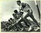 1987 Press Photo High School Boys Track Runners at 3200 Race Starting Line