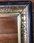 ANTIQUE MAHOGANY GESSO AND GILT DETAILED FRAME