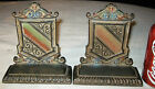 ANTIQUE CAST IRON SHIELD MEMORIAL WAR FRATERNAL ART STATUE PAINTING BOOKENDS