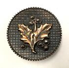Medium steel cup button with a leaf design and cut steel berries. Mint!