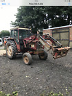 International 574 tractor with quickie loader and quick release 100 reliable