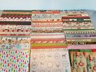 100 Sheets of 12x12 Christmas themed scrapbook paper various brands