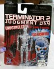 Terminator 2 Judgement Day Endoskeleton Figure with Phase Plasma Rifle NOS 1995