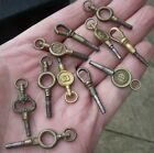 ELEVEN ANTIQUE POCKET WATCH KEYS, VARIOUS SIZES.