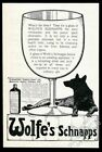 1910 Wolfes Schnapps glass and wolf art UK vintage print ad