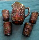 Marigold Carnival Glass Pitcher And Tumblers