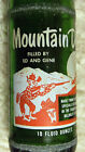 Mountain Dew, 10 oz., 1965. Filled by Ed and Gene. Hillbilly bottle.