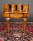 Oval Queen Anne walnut writing desk with top cabinet fitted with six d... Lot 94