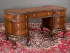 Chippendale mahogany desk with oval shape ends, carved top and on car... Lot 163