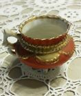 Old ~ Four Legged Porcelain Cup ~ With Gold Tone Accents Rim and Handle ~ 2 1/4