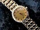 LADY'S BAUME & MERCIER 18KT 750 GOLD DIAMOND AND RUBY WATCH 16760 WOMANS NICE!!!