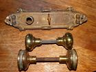 TWO ANTIQUE  ORNATE BRASS DOOR KNOBS WITH  PLATE