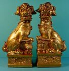 PAIR VINTAGE CHINESE GOLD LACQUERED RESIN SEATED FOO DOG FIGURINES