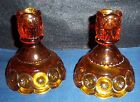 PAIR OF AMBER GLASS CANDLE STICK HOLDERS 4 1/2