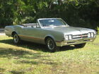 1966 Oldsmobile Cutlass convertible 1966 Oldsmobile Cutlass Convertible 4 speed