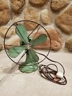 Vintage Green 4 Blade Desk Fan 10 tall with metal guards  tilts Works great