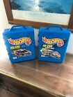 2 hot wheels storage cases and cars
