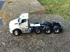 150 Scale Kenworth T880 SBFA Daycab Tractor w Lift Axle White 71058