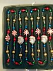 2004 THOMAS PACCONI GLASS GARLAND SANTA HEADS AND PEPPERMINTS