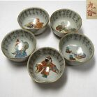 A185: Japanese KUTANI pottrey ware five SAKE cups with good painting.
