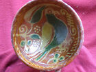 Authentic early 17th. century nice Dutch slipware bowl with a bird pigeon decor