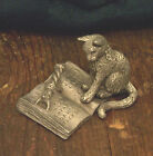 Master Kitty pointing out the right page  - - SunGlo Pewter Designs