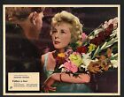 Follow a Star Lobby Card-Norman Wisdom giving flowers to June Laverick.