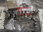 Bernina attachments, 12 pressure foots one new in box others ex cond.
