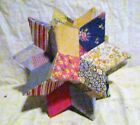 A EARLY MORAVIAN STAR DOORSTOP MADE WITH VINTAGE FABRIC
