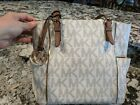 Micheal kors Signiture tote cream color with gold trim