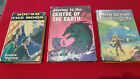 VINTAGE JULES VERNE BO OKS X 3. ALL HARD COVERS, 1 HAS A JACKET. NICE LOT.